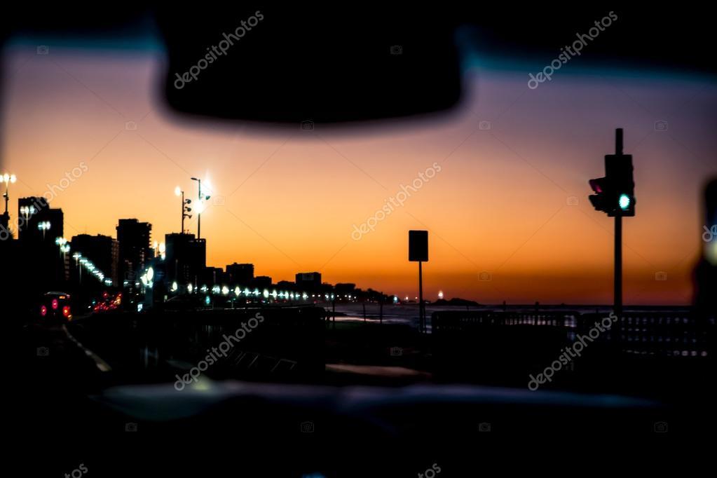 Sunrise inside the car in Ipanema