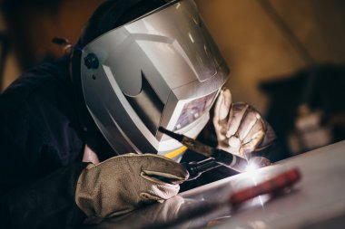 welder using acetylene welding outfit