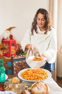 Woman Serving Italian Tomato Pasta