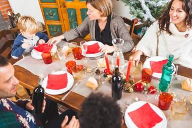 Family Gathers for Christmas Dinner