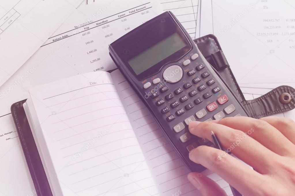 Savings, Finances, Economy And Office Concept. Business People Counting On  Calculator, Notebook