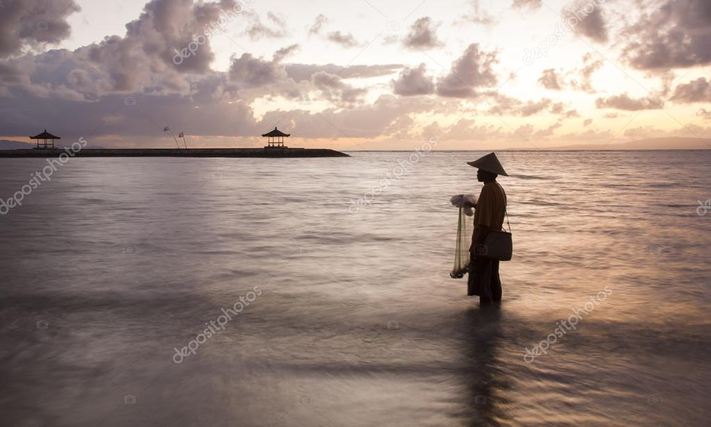 old fisherman in a sea in Bali