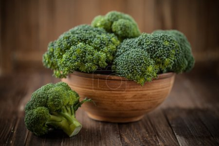 Broccoli in a bowl on a wooden background