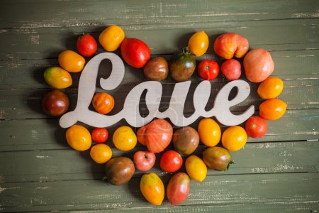 Love tomatoes on a gray wooden background