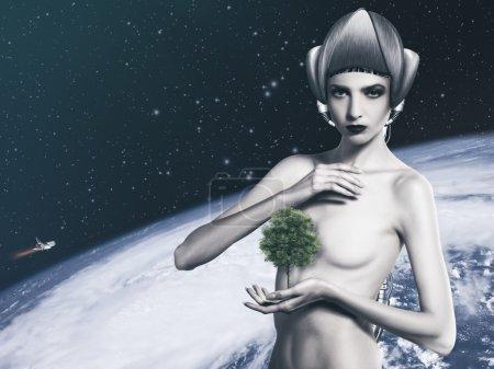 Cyborg woman holding tree