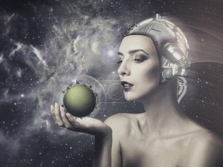 Cyborg woman holding green planet