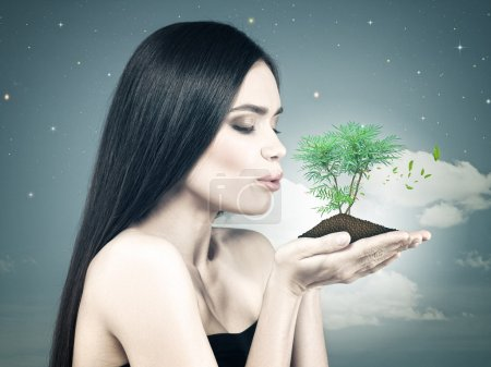 Photo for Eco female portrait with beauty white girl holding green bud on to her palms - Royalty Free Image