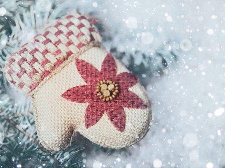 Santa mittens in snow