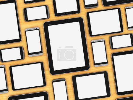 Photo for Creative abstract mobility and digital wireless communication technology business concept: group of blank tablet computer PC and empty modern touchscreen smartphones or mobile phones on wooden table - Royalty Free Image