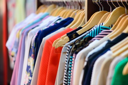Photo for Variety of clothes hanging on rack in boutique - Royalty Free Image