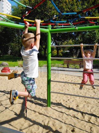 Photo for Little excited children playing at sandy playground - Royalty Free Image