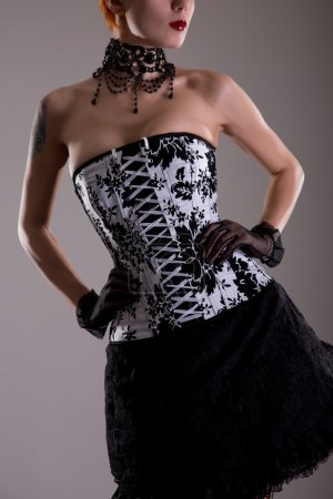 Woman in black and white corset
