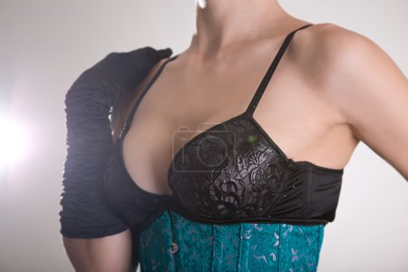 Woman in bra and corset