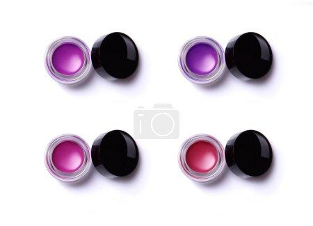 Set of lip glosses in jars