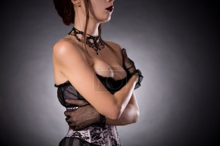 Busty woman in Victorian corset