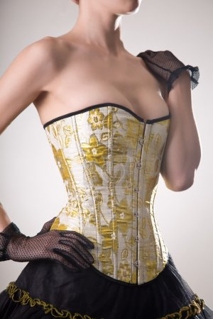 Attractive young woman in burlesque corset and skirt
