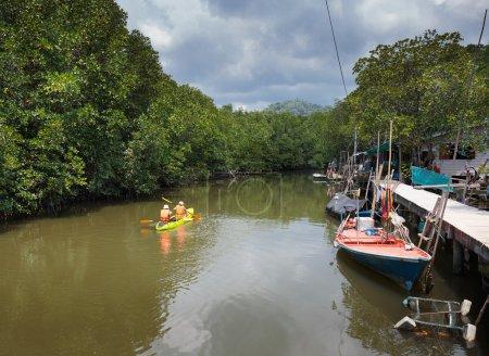Tourists kayaking floating on river