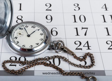 Pocket watch on the calendar