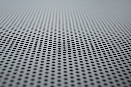 Metallic background with perforation