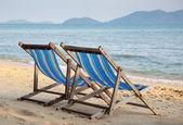 Two beach chairs on tropical beach