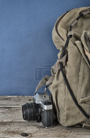 Old travel backpack  and camera