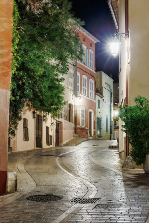 Narrow old street at night in Saint-Tropez