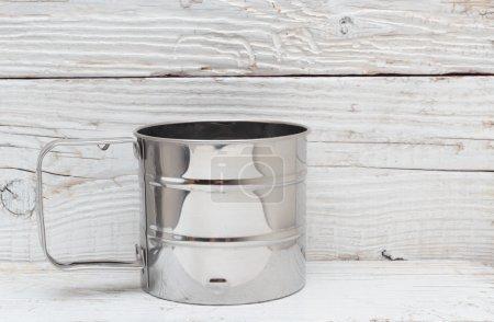 Empty metal mug on table