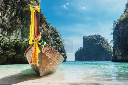 Photo for Traditional Thai Longtail boat and island of Phi Phi Leh on the horizon,Thailand - Royalty Free Image