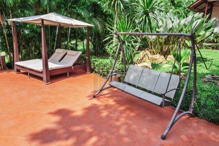 Swing on the patio in garden