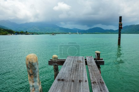 Photo for Old wooden jetty on exotic beach of a tropical island Koh Chang,Thailand - Royalty Free Image