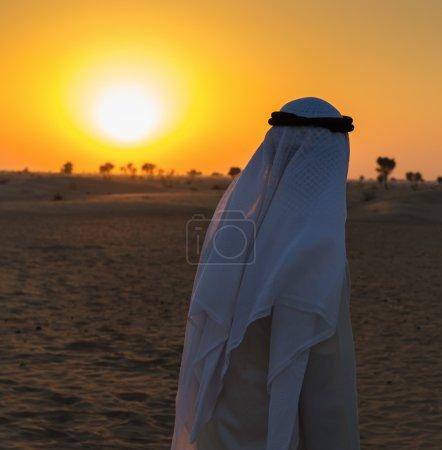 Arab man watching the sunset
