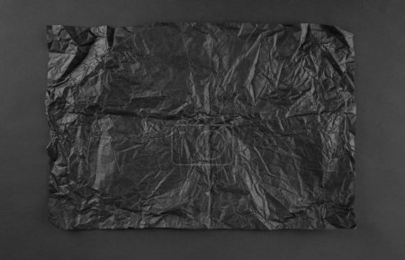 black crumpled paper