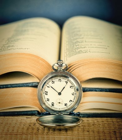pocket watch and books