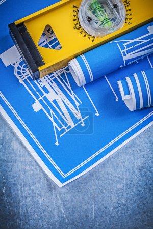 Rolls of blue engineering drawings