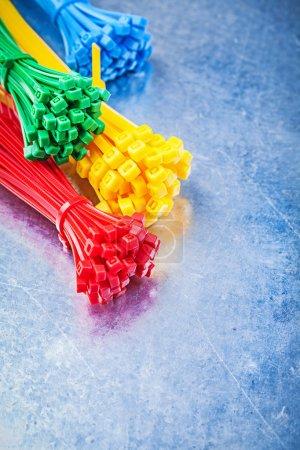 Multicolored plastic self-locking tying