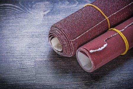 Rolled sandpaper on vintage board