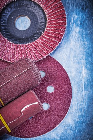 Photo for Flap grinding discs abrasive wheels rolled sandpaper on metallic background. - Royalty Free Image