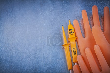 Insulating gloves, electrical tester