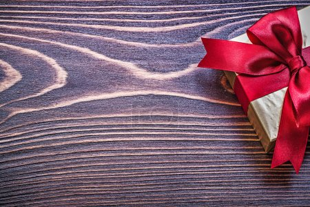 Present box with red satin bow