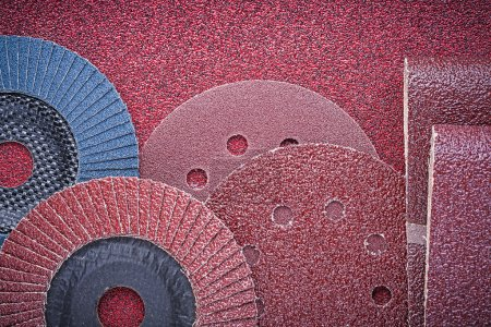 Rolled abrasive papers and grinding wheels
