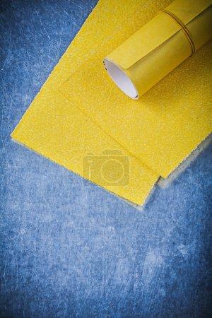 Yellow sandpapesr on metal