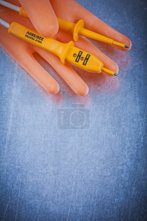Insulating gloves and electric tester