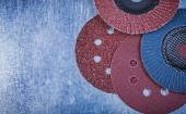 Sanding discs and grinding wheels