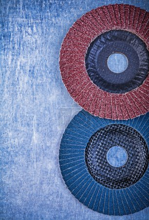 Photo for Abrasive flap wheels on metallic background. - Royalty Free Image