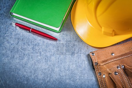 Tool belt, hard hat and notepad