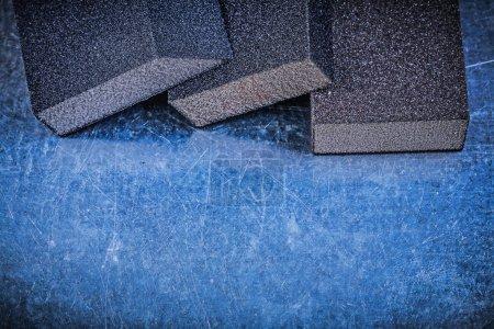 Abrasive sponges on scratched metal