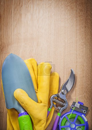 Protective gloves, hand spade and secateurs