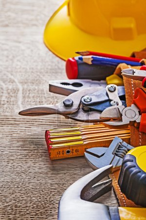 Photo for Close up view on working tools in toolbelt on wooden board. - Royalty Free Image