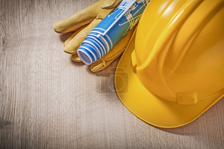 Hard hat and leather protective gloves