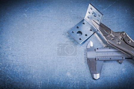 Pliers, vernier caliper and angle bracket